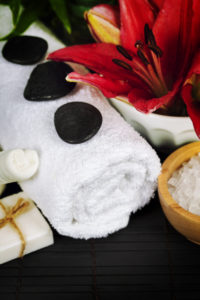 Spa concept (flowers, towel, sea salt and massage stones)